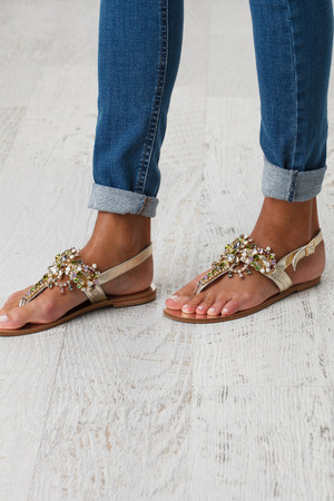 38798658 - woman legs in blue jeans and summer shoes